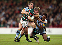 Photo: Rich Eaton.<br /> <br /> Cardiff Blues v Leicester Tigers. Heineken Cup. 29/10/2006. Ollie Smith of Leicester Tigers is tackled by Mosese Luveitasau right and Marc Stcherbina left of Cardiff