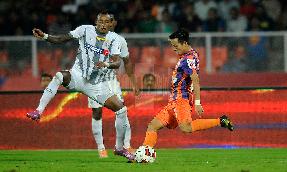 Fikru Tefera Lemessa of Atletico de Kolkata and Park Kwang-il of FC Pune City during match 44 of the Hero Indian Super League between FC Pune City and Atletico de Kolkata FC held at the Shree Shiv Chhatrapati Sports Complex Stadium, Pune, India on the 29th November 2014.<br /> <br /> Photo by:  Pal Pillai/ ISL/ SPORTZPICS