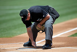 OAKLAND, CA - JULY 23: MLB umpire Marvin Hudson #51 brushes off home plate during the first inning between the Oakland Athletics and the Toronto Blue Jays at O.co Coliseum on July 23, 2015 in Oakland, California. The Toronto Blue Jays defeated the Oakland Athletics 5-2. (Photo by Jason O. Watson/Getty Images) *** Local Caption *** Marvin Hudson