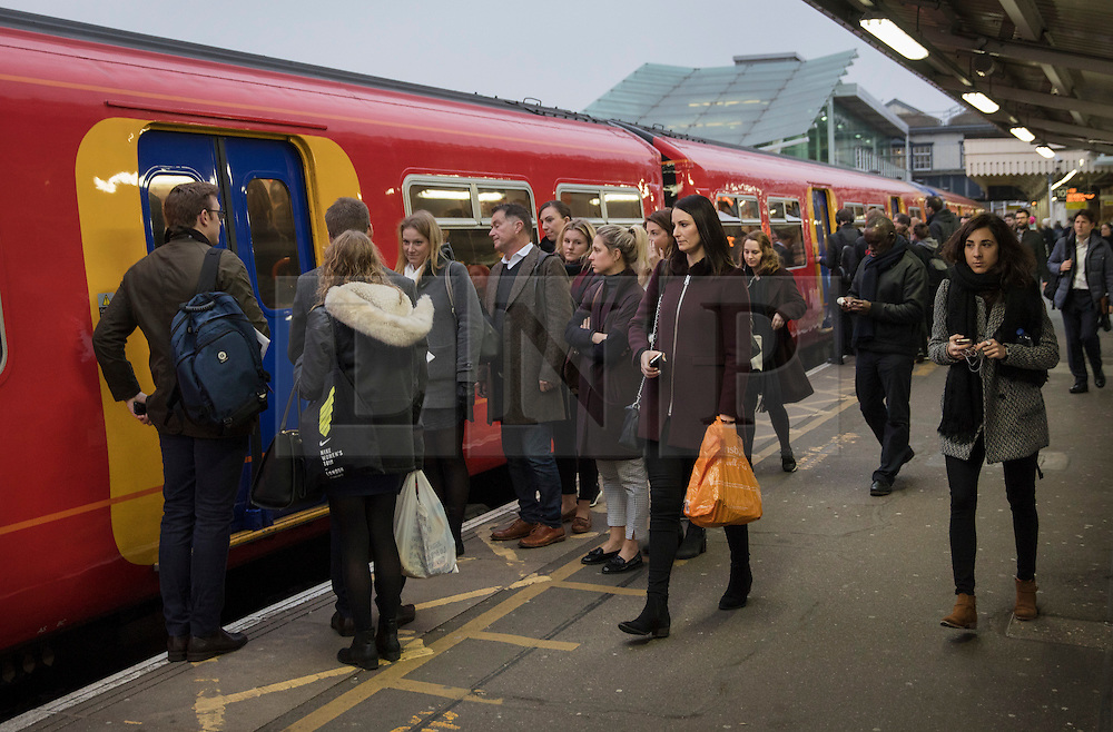 © Licensed to London News Pictures. 19/12/2016. London, UK. Passengers wait for trains at Clapham Junction. Some Southern Rail services are running today as ASLEF union drivers started a two day strike in a dispute over driver-only operated trains. Photo credit: Peter Macdiarmid/LNP