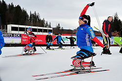 Warming up at the 2014 IPC Nordic Skiing World Cup Finals - Middle Distance