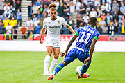 Leeds United midfielder Kalvin Phillips (23) passes the ball during the EFL Sky Bet Championship match between Wigan Athletic and Leeds United at the DW Stadium, Wigan, England on 17 August 2019.