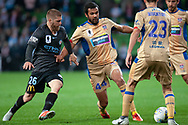 Melbourne City midfielder Luke Brattan (26) and Newcastle Jets defender Nikolai Topor-Stanley (44) fight over the ball at the FFA Cup Round 16 soccer match between Melbourne City FC v Newcastle Jets at AAMI Park in Melbourne.
