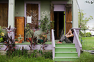 Life beginning to return to normal in the Lower 9th ward one year after hurricane Katrina. Kathleen Kraus sits on her porch waiting for the City to restore her electricity. The cables were cut by the City to prevent fires from electrical shorts..