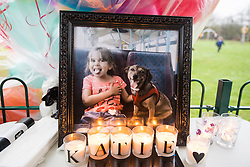 © Licensed to London News Pictures. 16/01/2017. York UK.Picture shows candles & a picture of Alison Rough. Katie Rough's parents Paul Rough & Alison Rough where joined by hundreds of people in Westfield Park in York this afternoon to release balloons on what would have been Katie's 8th birthday. Katie died last week after being found with significant cuts to her neck & chest.  Photo credit: Andrew McCaren/LNP