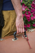 person holding a heavy case by its handle