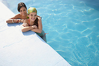 Two teenage girls (16-17) in swimming pool portrait elevated view