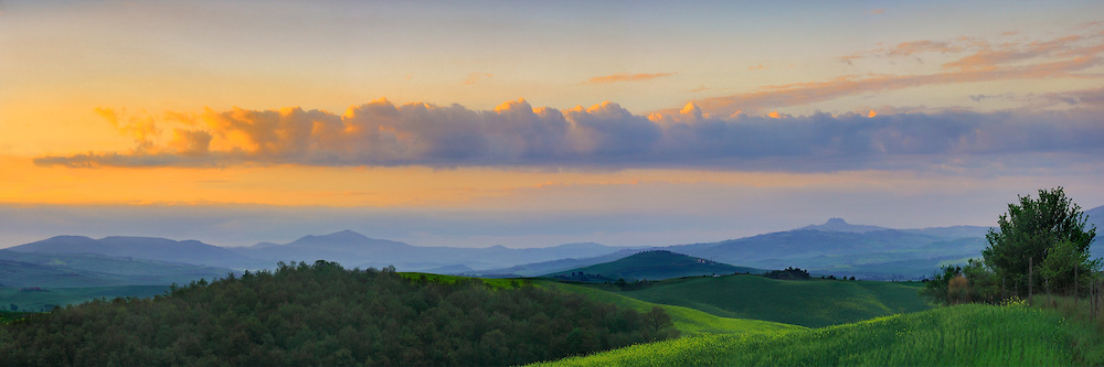 The sky started to clear off right at sunrise, after a night of mighty thunderstorms. Taken in the hills between  Pienza and San Quirico d'Orcia in Tuscany, Italy, on a morning at the beginning of May. The medieval fortified town of Radicofani is in the background. Stitched from ten vertical frames.