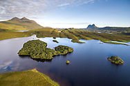 Trees on an island in Cam Loch escape escape the grazing pressures of the surrounding landscape in Assynt.