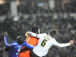Chelsea Kurt Zouma, falls to the floor knocked out after receiving a fist in the jaw, from Derby Richard Keogh Derby County v Chelsea, Capital One Cup Quarter Final, Score Derby 1(Bryson),  Chelsea 3 (Hazard, Luis, Schurrle) Pride Park Tuesday 16th December 2014