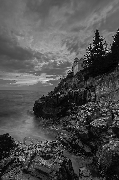 Black and White New England photography of the iconic Bass Harbor Head Light located on Mount Desert Island within Maine Acadia National Park on the southeast corner of MDI. The lighthouse towers over the swirling Atlantic Ocean and seacoast, marking the entrance to Bass Harbor and Blue Hill Bay. It is one of the most iconic scenery of Acadia NP as Bass Harbor Light is dramatically located on the edge of rugged cliffs.<br /> <br /> This classic B&amp;W New England lighthouse photography image is available as museum quality photography prints, canvas prints, acrylic prints or metal prints. Fine art prints may be framed and matted to the individual liking and decorating needs:<br /> <br /> http://juergen-roth.pixels.com/featured/new-england-black-and-white-photography-of-bass-harbor-lighthouse-juergen-roth.html<br /> <br /> Good light and happy photo making! <br /> <br /> My best, <br /> <br /> Juergen<br /> Website: www.RothGalleries.com<br /> Twitter: @NatureFineArt<br /> Facebook: https://www.facebook.com/naturefineart<br /> Instagram: https://www.instagram.com/rothgalleries
