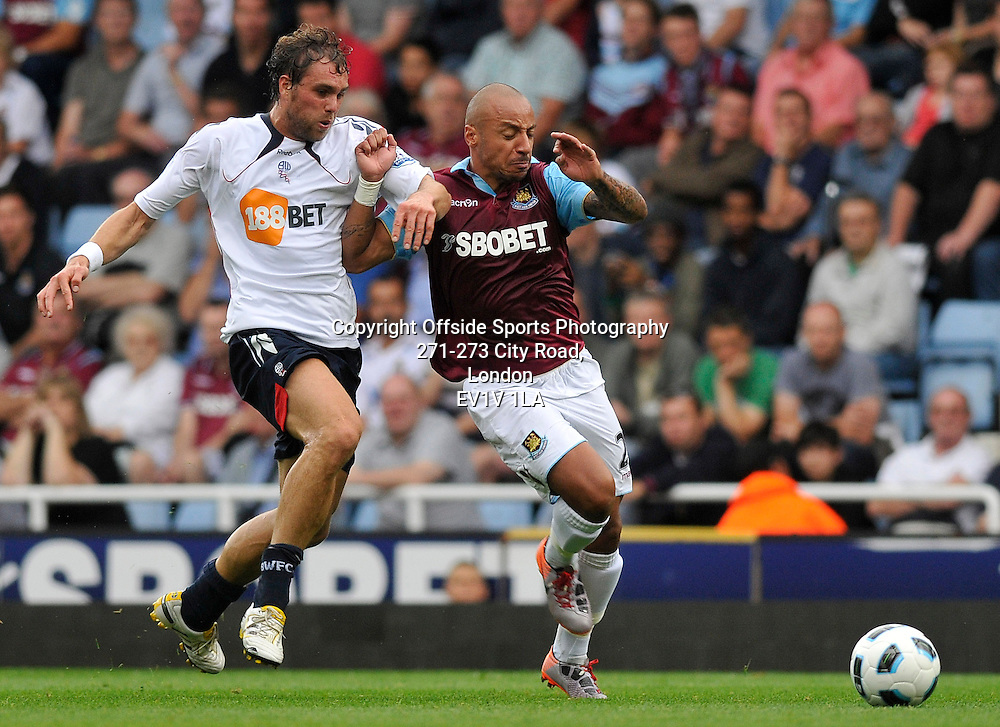 21/08/2010 - Premiership Football - West Ham United vs Bolton Wanderers - Bolton's Johan Elmander tries to get around West Ham's Julien Faubert. - Photo: Charlie Crowhurst / Offside.