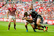 Wigan Warriors centre Oliver Gildart (4) is stopped bob Hull FC centre Josh Griffith (4)  during the Ladbrokes Challenge Cup Final 2017 match between Hull RFC and Wigan Warriors at Wembley Stadium, London, England on 26 August 2017. Photo by Simon Davies.