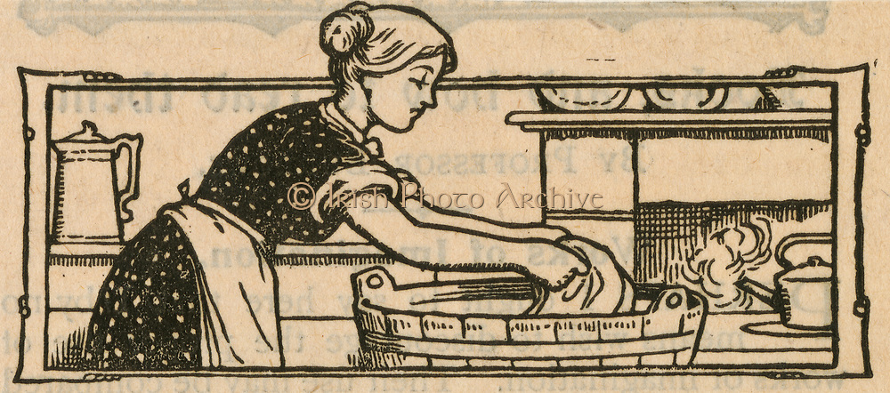 Woman doing the washing in a tub. Engraving,1904.