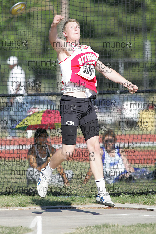 Timothy Nedow competing in the juvenile boys discus at the 2007 OTFA Supermeet II. The Ontario Track and Field Association Bantam-Midget-Juvenile Championships were held in Toronto from August 3rd to 5th.