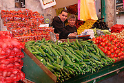 Israel, West Jerusalem Machane Yehuda market shopkeepers at their vegetable stall