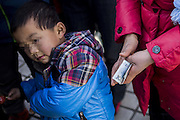 QINGDAO, CHINA - DECEMBER 20: (CHINA OUT)<br /> <br /> Mother Sells Son To Save Daughter<br /> <br /> A mother sells her son to save her daughter who has leukemia at Weihai Road on December 20, 2014 in Qingdao, Shandong province of China. A woman held a board with Selling son to save daughter because her daughter had got leukemia and her poor family could not afford the expensive medical bills. <br /> ©Exclusivepix Media