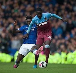 Moise Kean of Everton (L) tackles Arthur Masuaku of West Ham United - Mandatory by-line: Jack Phillips/JMP - 19/10/2019 - FOOTBALL - Goodison Park - Liverpool, England - Everton v West Ham United - English Premier League