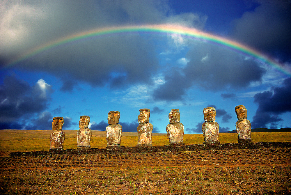 The full arc of a rainbow spans Ahu Akivi, on Easter Island, a World Heritage Site.