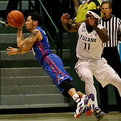 Jan 17, 2016; New Orleans, LA, USA; Southern Methodist Mustangs guard Nic Moore (11) is tripped up by Tulane Green Wave guard Kain Harris (11) during the second half of a game at the Devlin Fieldhouse. Southern Methodist defeated Tulane 60-45. Mandatory Credit: Derick E. Hingle-USA TODAY Sports