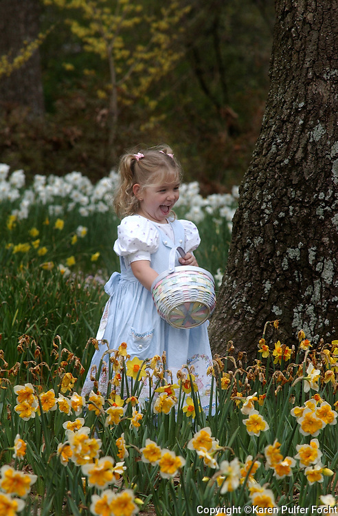 A child plays in the garden, at Memphis Botanic Gardens,  during and Easter Egg Hunt.