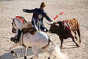 A rejoneador on horseback in the arena at Ste-Maries-de-la-Mer, Camargue, France