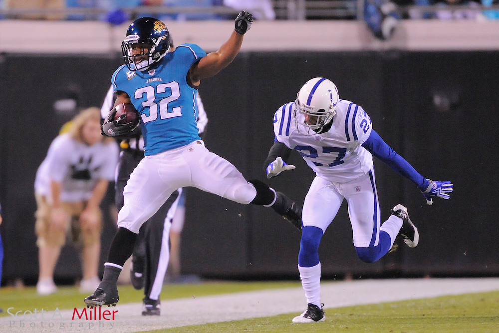 Dec. 17, 2009; Jacksonville, FL, USA; Jacksonville Jaguars running back Maurice Jones-Drew (32) is forced out of bounds by Indianapolis Colts cornerback Jacob Lacey (27) during the first half at Jacksonville Municipal Stadium. ©2009 Scott A. Miller.© 2009 Scott A. Miller
