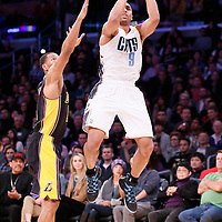 31 January 2014: Charlotte Bobcats shooting guard Gerald Henderson (9) takes a jumpshot past Los Angeles Lakers small forward Wesley Johnson (11) during the Charlotte Bobcats 110-100 victory over the Los Angeles Lakers at the Staples Center, Los Angeles, California, USA.