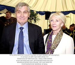 MR & MRS GEORGE WALKER founder of Brent Walker, at a reception in London on 26th April 2001.ONG 117