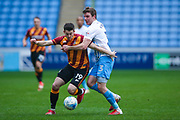 Bradford City forward Alex Jones (19) shields the ball from Coventry City defender Chris Stokes (3)  during the EFL Sky Bet League 1 match between Coventry City and Bradford City at the Ricoh Arena, Coventry, England on 11 March 2017. Photo by Simon Davies.