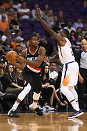 Oct 11, 2017; Phoenix, AZ, USA; Portland Trail Blazers forward Maurice Harkless (4) handles the ball against Phoenix Suns guard Eric Bledsoe (2) in the first half at Talking Stick Resort Arena. Mandatory Credit: Jennifer Stewart-USA TODAY Sports