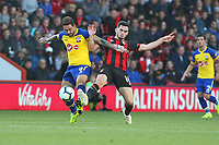 Football - 2018 / 2019 Premier League - AFC Bournemouth vs. Southampton<br /> <br /> Southampton's Danny Ings and Bournemouth's Lewis Cook tussle for the ball during the Premier League match at the Vitality Stadium (Dean Court) Bournemouth<br /> <br /> COLORSPORT/SHAUN BOGGUST