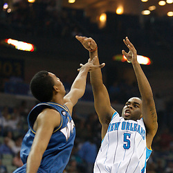 Mar 31, 2010; New Orleans, LA, USA; New Orleans Hornets guard Marcus Thornton (5) shoots over Washington Wizards guard Shaun Livingston (2)during the first half at the New Orleans Arena. Mandatory Credit: Derick E. Hingle-US PRESSWIRE
