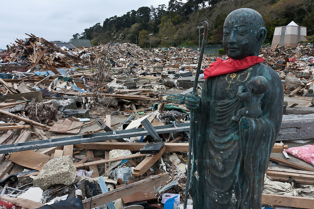 A Buddhist statue stands among ruined buildings and personal items in the debris of Ishinomaki city in Miyagi prefecture, Japan Friday May 6th 2011. Ishinomaki bore the brunt of the magnitude 9 earthquake that struck the Tohoku coast on March 11th and the town was almost completely destroyed by the large tsunami that followed the quake 20 minutes later