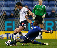 Photo: Steve Bond/Sportsbeat Images.<br />Leicester City v West Bromwich Albion. Coca Cola Championship. 08/12/2007. Darren Kenton (R) slides in on Jonathan Greening (L)