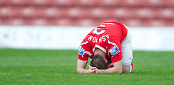 WREXHAM, WALES - Monday, May 7, 2012: Wrexham's Neil Ashton looks dejected as his side lose 3-2 on aggregate (2-1) to Luton Town during the Football Conference Premier Division Promotion Play-Off 2nd Leg at the Racecourse Ground. (Pic by David Rawcliffe/Propaganda)