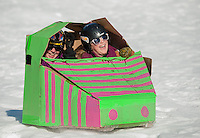 "Emily O'Connor and Reese Clark in their ""Remi"" take a wild ride at Gilford Outing Club for the annual Gilford Parks and Recreation Cardboard Sled Derby Wednesday morning.  Their sled took 1st in the Best Use of Cardboard and 3rd in the Fastest Sled (+10) division.  (Karen Bobotas/for the Laconia Daily Sun)"
