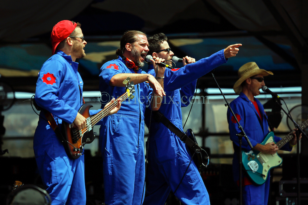 24 April 2016. New Orleans, Louisiana.<br /> The New Orleans Jazz and Heritage Festival. <br /> The Imagination Movers. L/R; Dave Poche, Scott Durbin, Rich Collins, Scott 'Smitty' Smith perform on the Gentilly Stage.<br /> Photo; Charlie Varley/varleypix.com