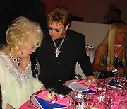 Elizabeth Taylor, Elton John and Donatella Versace..**EXCLUSIVE**.2003 amFAR Cinema Against Aids-Cannes Film Festival.Moulin de Mougins..Thursday, May 22, 2003..Mougins, France..Photo By Celebrityvibe.com.To license this image please call (212) 410 5354; or .Email: CelebrityVibe@gmail.com ; .website: www.CelebrityVibe.com.**EXCLUSIVE**