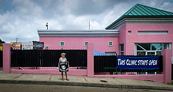 A pro-life activist stands outside the Jackson Women's Health Organization clinic, on Tuesday August 19, 2014, in Jackson, Mississippi. This is the only clinic in the entire state that performs abortions. (Photo © Jock Fistick)