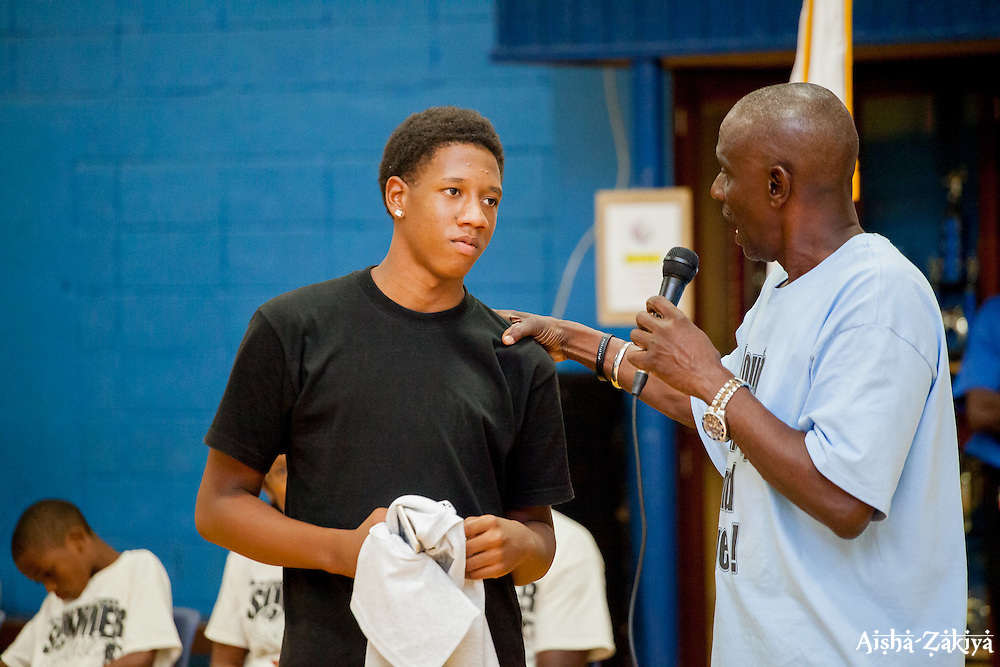 Keynote speaker Keith Benjamin speaks directly to player Ja'Quan Gumbs who says he'd like to go on to study engineering.  Milton M. Newton Summer Classic Basketball Single Elimination 13-16 CoEd Tournament at the Charlotte Amalie High School Gymnasium.  St. Thomas, USVI.  8 August 2016.  © Aisha-Zakiya Boyd