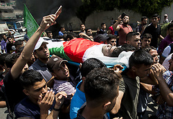 July 7, 2018 - Gaza City, The Gaza Strip, Palestine - Palestinian citizens carry the body of Mohammed Abu Halima, 22, who was shot by Israeli soldiers during a protest on the Gaza Strip border with Israel during his funeral in Gaza on Saturday, July 7, 2018. (Credit Image: © Mahmoud Issa/Quds Net News via ZUMA Wire)