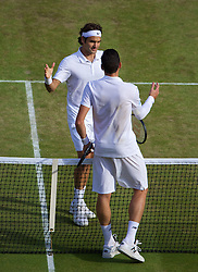 04.07.2014, All England Lawn Tennis Club, London, ENG, ATP Tour, Wimbledon, im Bild Roger Federer (SUI) and Milos Raonic (CAN) after the Gentlemen's Singles Semi-Final match on day eleven // during the Wimbledon Championships at the All England Lawn Tennis Club in London, Great Britain on 2014/07/04. EXPA Pictures © 2014, PhotoCredit: EXPA/ Propagandaphoto/ David Rawcliffe<br /> <br /> *****ATTENTION - OUT of ENG, GBR*****