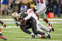 28 November 2011: Wide receiver (19) Devery Henderson of the New Orleans Saints catches a pass and is tackled by (31) Aaron Ross of the New York Giants during the first half of the Saints 49-24 victory over the Giants at the Mercedes-Benz Superdome in New Orleans, LA.