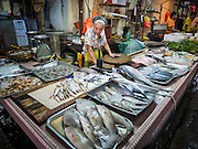 05 JUNE 2015 - KUALA LUMPUR, MALAYSIA: A person selling fresh fish in a wet market near the Chinatown section of Kuala Lumpur.     PHOTO BY JACK KURTZ