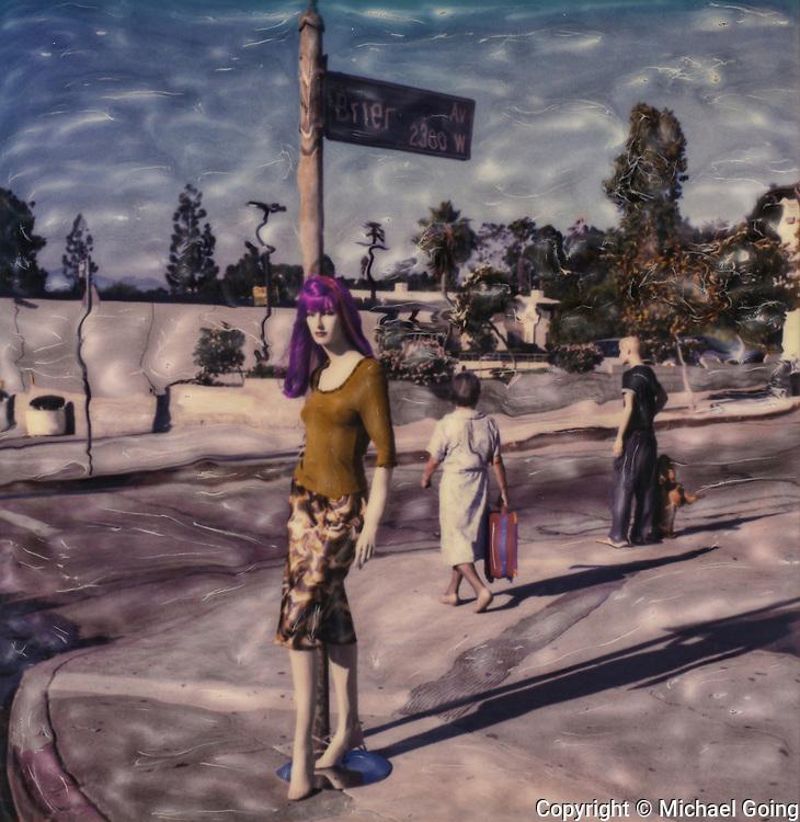 Purple haired mannequin on street corner