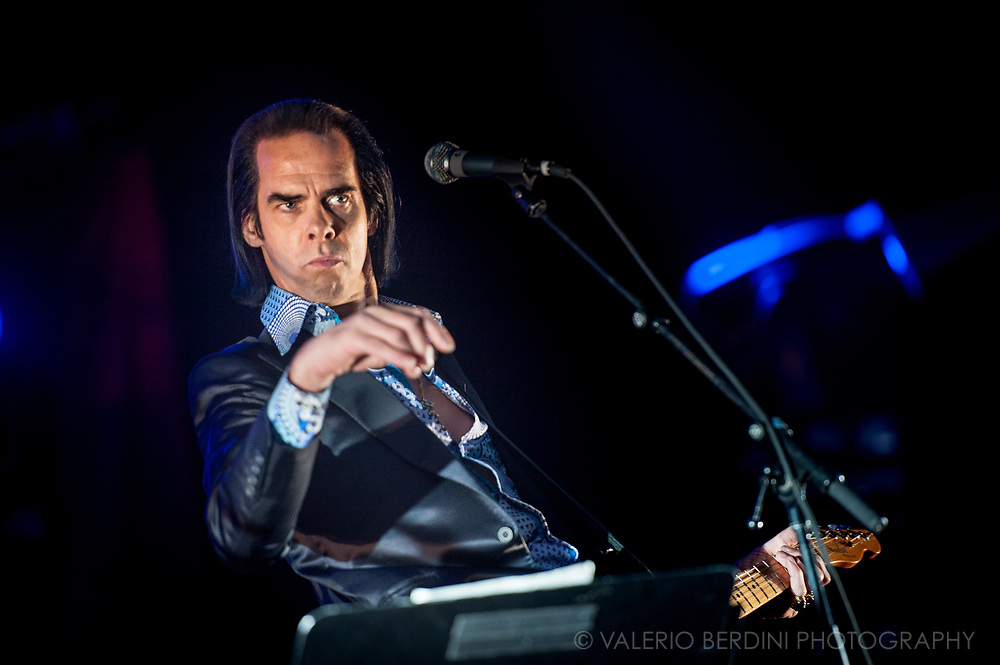 Nick Cave on stage with Grinderman at I'll Be Your Mirror Festival in London in 2011