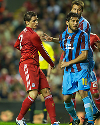 LIVERPOOL, ENGLAND - Thursday, August 19, 2010: Liverpool's Fernando Torres swings a punch at Trabzonspor's Egemen Korkmaz during the UEFA Europa League Play-Off 1st Leg match at Anfield. (Pic by: David Rawcliffe/Propaganda)