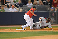Mississippi's Zach Miller (1) tags out  Arkansas' Monk Kreder (9) at third base in a college baseball game at Oxford-University Stadium in Oxford, Miss. on Friday, May 7, 2010. Arkansas won 11-4.