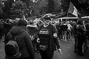Ms. Selene Ticchi, 48 years old is seen during the march wearing a t-shirt reppresenting the Auschwitz concentration camp as Disneyland. 'It's black humor' she said. About 2000 fascists gathered in Predappio, Italy to commemorate the annivrsary of the 'Marcia su Roma' A march held on October 28th 1922 and marked the start of the Italian fascist era .Federico Scoppa